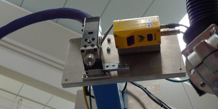 Camara para triangulacion laser en inspeccion de cordones de mastico